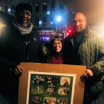 Pittsburgh Steelers legends Franco Harris and Joe Greene visit with Linda Barnicott at the Holiday Market in Market Square.