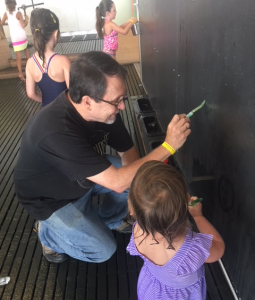 Tom Barnicott, husband of Linda Barnicott, spends time with his granddaughter, Aria, at the Children's Museum.