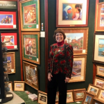 Linda Barnicott, Pittsburgh's Painter of Memories, poses in her booth at the Pittsburgh Home and Garden Show.