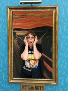 "Linda Barnicott, Pittsburgh's Painter of Memories, poses in a reproduction of Edvard Munch's ""The Scream."""