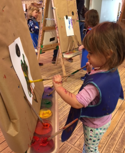 Linda Barnicott's granddaughter, Aria, paints at the Pittsburgh Children's Museum.