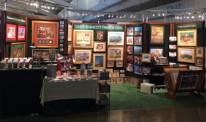 This photo features the Pittsburgh Home and Garden Show booth of Linda Barnicott, Painter of Memories.