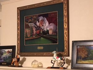 "This photo features Linda Barnicott's painting ""All Aboard with Santa."""
