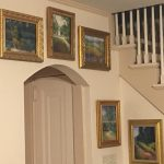 This photo features some of Linda Barnicott's landscapes hung above a door.