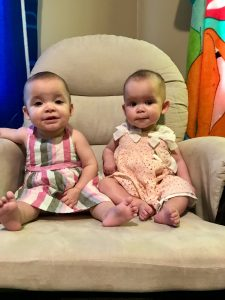 Abigail (left) and Autumn (right) Stadelman, granddaughters of Linda Barnicott, smile for their 9 month old photos.