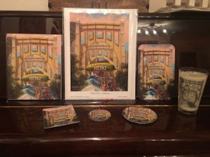 "This image features the different products available with Linda Barnicott's new painting ""Pickle Fun In Pittsburgh"": print, borderless 8x10, sandwich tray, mint tray, ornament, coaster, and pint glass."