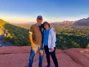This image features Linda Barnicott with her husband, Tom, in the mountains of Sedona, Arizona.