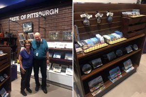 Two photos: one of Linda Barnicott in one of the stores at the Pittsburgh International Airport. The second photo features her work displayed at a store in the Pittsburgh International Airport.