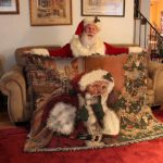 "Santa Claus holding Linda Barnicott's new throw blanket that features her ""Shhhh!"" painting."