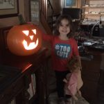 This image shows Aria, granddaughter of Linda Barnicott, with a pumpkin she carved.