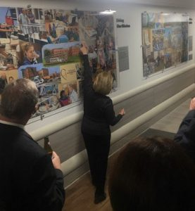 In this image, Linda Barnicott points out different features of her murals lining the walls of Forbes Hospital in Monroeville, Pennsylvania.